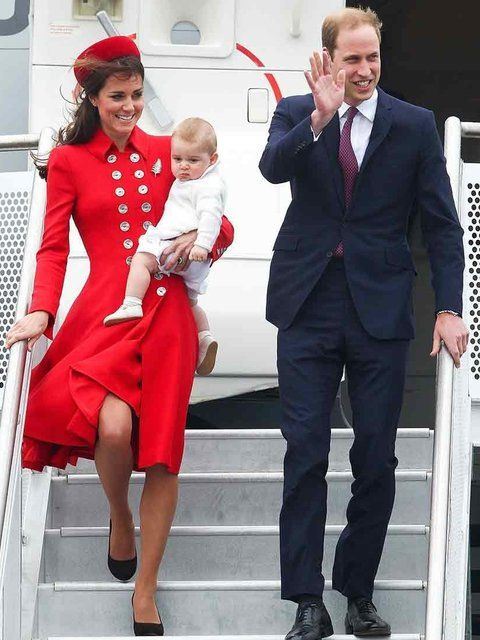 Kate Middleton, with Princes William and George, wears Catherine Walker as they arrive at Wellington Airport in New Zealand, April 2014.