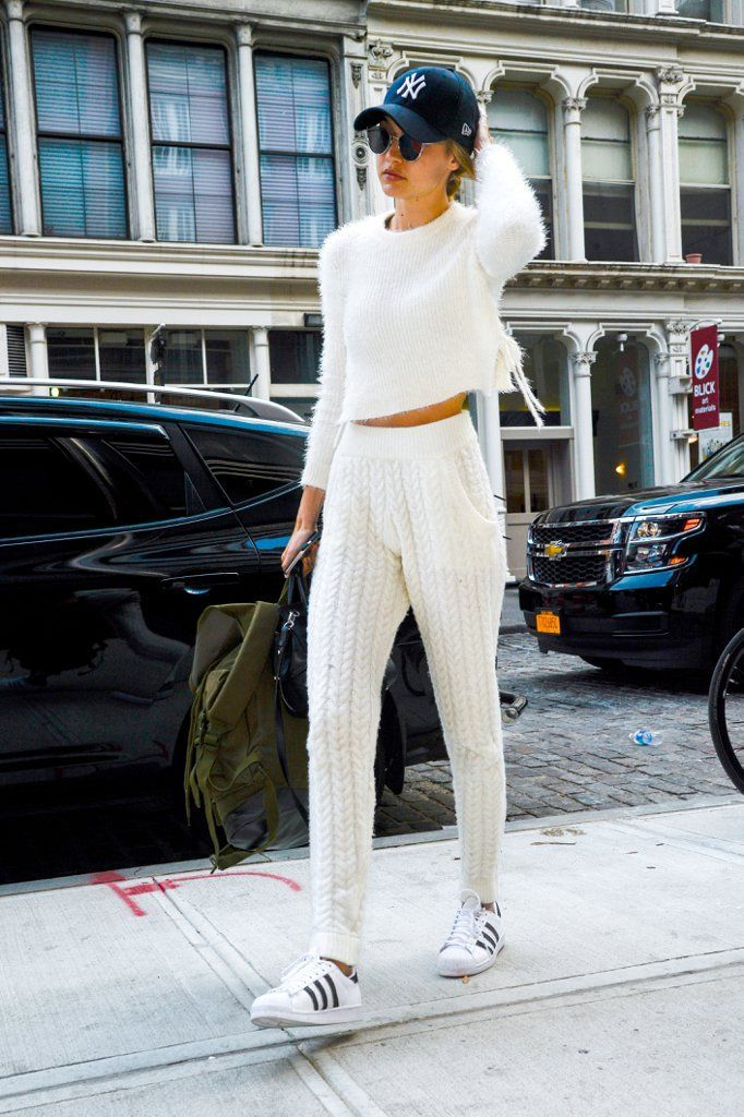 Gigi Wore Her Yankees Hat With a Fuzzy Sweater and High-Waist Knit Pants.