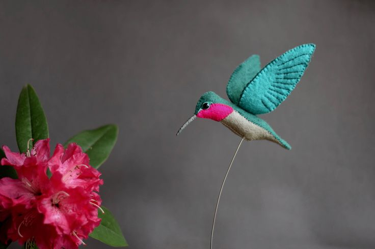 This hand embroidered ornament is my very first hummingbird and looks spectacular displayed next to a vase of freshly cut valentine flowers for that romantic feel.  Constructed carefully using wire wrapped together with alpaca fibres it is a completely natural figurine, balance on semi-flexible wire and a small block of raw pine. Approximately 16cm x 16 cm x 4cm wide.  Please contact me with any questions.