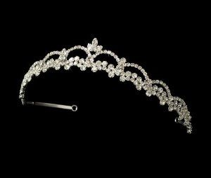 "Evelyn Crystal Wedding Bridal Tiara by Fairytale Bridal Tiara. $58.33. Silver Plated. Rhinestones. Simple and elegant, this rhinestone encrusted tiara is perfect for the classic, modern, or vintage bride. Lovely with your white or ivory wedding dress. The ornamented portion of the piece measures 9-1/4"" wide and 1-1/4"" tall at its center peak, and the piece ends with two loops that allow you to fasten it in your hair with bobby pins."
