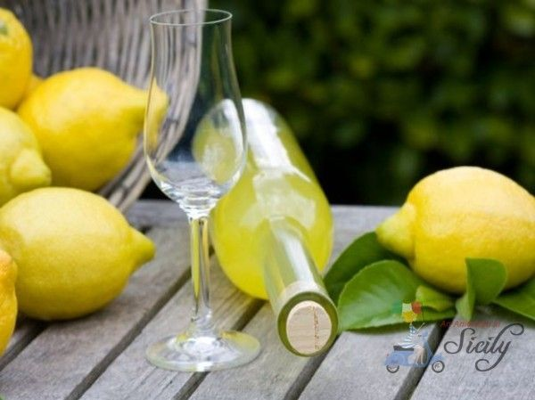 """Limoncello della Suocera (Mother-in-Law's Limoncello)......Of course here in Sicily, I've tasted a lot of Limoncello done by different women, or store bought. And I have to say, really, my mother-in-law makes the best Limoncello. Hers isn't too """"lemon-y"""" or """"alchohol-y"""", and for someone who doesn't drink much liquor (apart wine! =) I find her Limoncello to be the most....."""