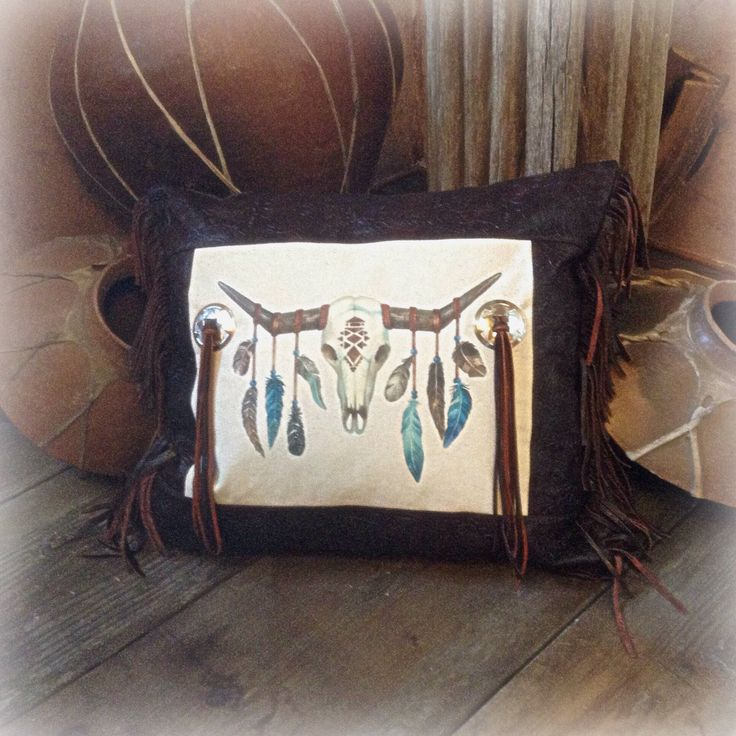 Western feathered longhorn skull and faux leather fringe pillow by WBrandDesigns on Etsy https://www.etsy.com/listing/497984644/western-feathered-longhorn-skull-and