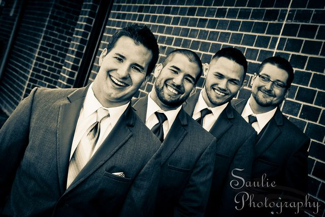 Wedding photography pose for Groom and groomsmen. On staircase with full bridal party each side of rail?