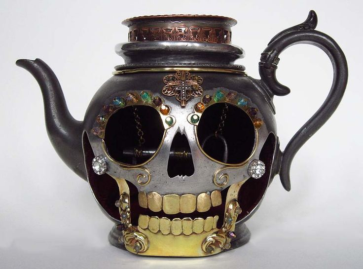 Forever - Skull memento mori candle holder. Made from an antique pewter teapot with reclaimed metals and crystal beads. The inside is lined with red velvet adn an antique key hangs from the centre. By Carola Del Mese