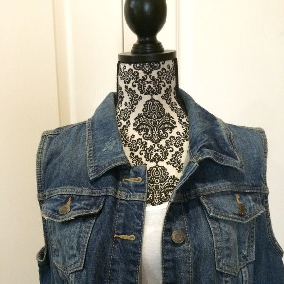 Sleeveless Denim Jacket Like new Sleeveless Denim Jacket. Jacket has 2 side pockets. 6 buttons down the front. Very cute. Worn once. Comes from a smoke free home. Mossimo Supply Co Jackets & Coats Jean Jackets