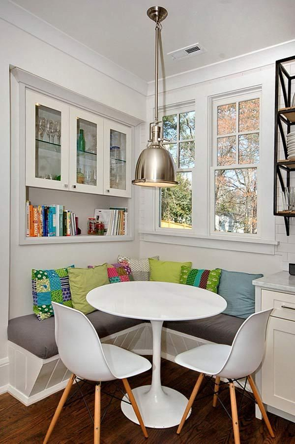 This is a nice, small space that's an interesting mix of modern and traditional decor. The chairs and light fixture are sleek and contemporary, while the cabinets are decidedly traditional.