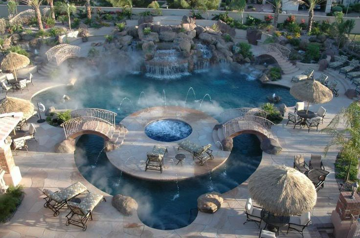 Resort-style Backyard: Cross the bridge to the island and warm up in the hot tub after taking a dip in the pool.