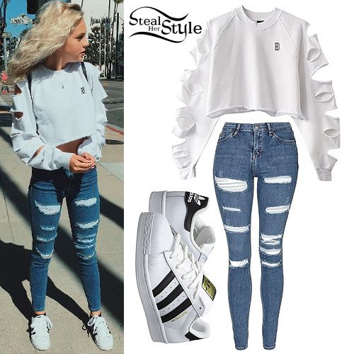 Jordyn Jones posted an instagram photo yesterday wearing the Blackdope Women's White Cropped Sweater with Cutouts (€50.00), Topshop Moto Jamie Shredded Skinny Jeans (sold out), and Adidas Originals White & Black Superstar Sneakers ($80.00).