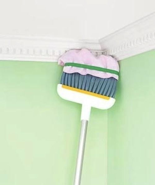 Towel + broom = a way to reach high, hard-to-clean spaces.   20 Simple Tricks To Make Spring Cleaning So Much Easier
