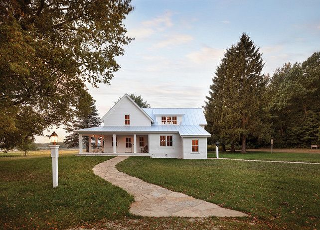 White Farmhouse With Wrap Around Porch And Metal Roof WhiteFarmhouse