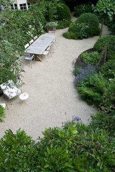 Just look at these lush beds next to the lovely neutral of pea gravel.