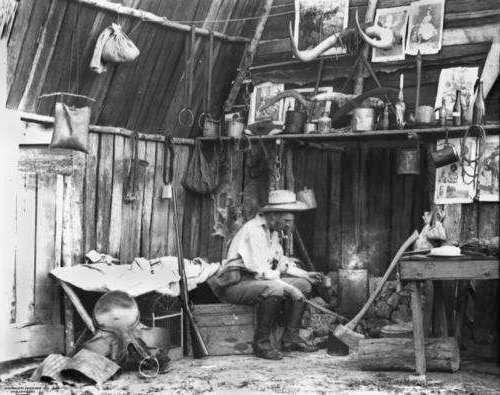 Bushman inside a slab hut circa 1870