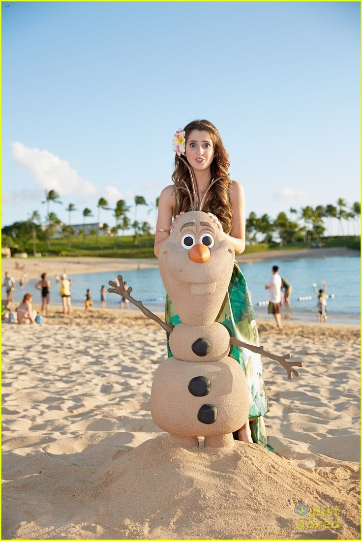 Laura Marano hangs out with her new friend while filming Disney Parks Frozen Christmas Celebration at Aulani on Sunday (November 30) in Oahu, Hawaii.