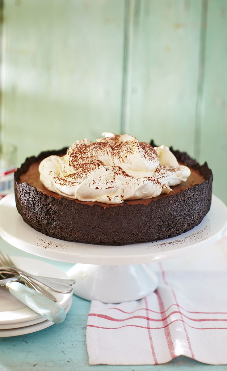 Triple chocolate Mississippi mud pie topped with whipped cream and a fine dusting of cocoa powder. A delicious recipe that friends and family will love.
