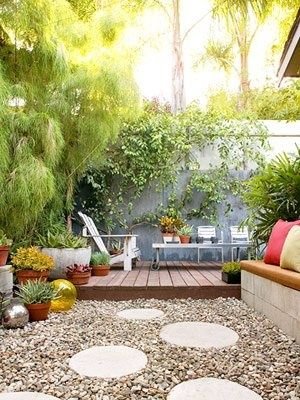 inexpensive concrete block bench, round pavers and pebbles rhymeswithpolka