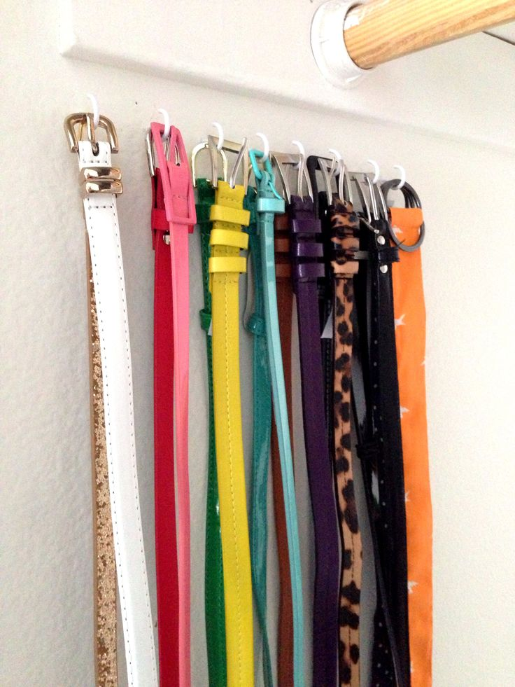 Hooks on the wall in the closet to organize belts.