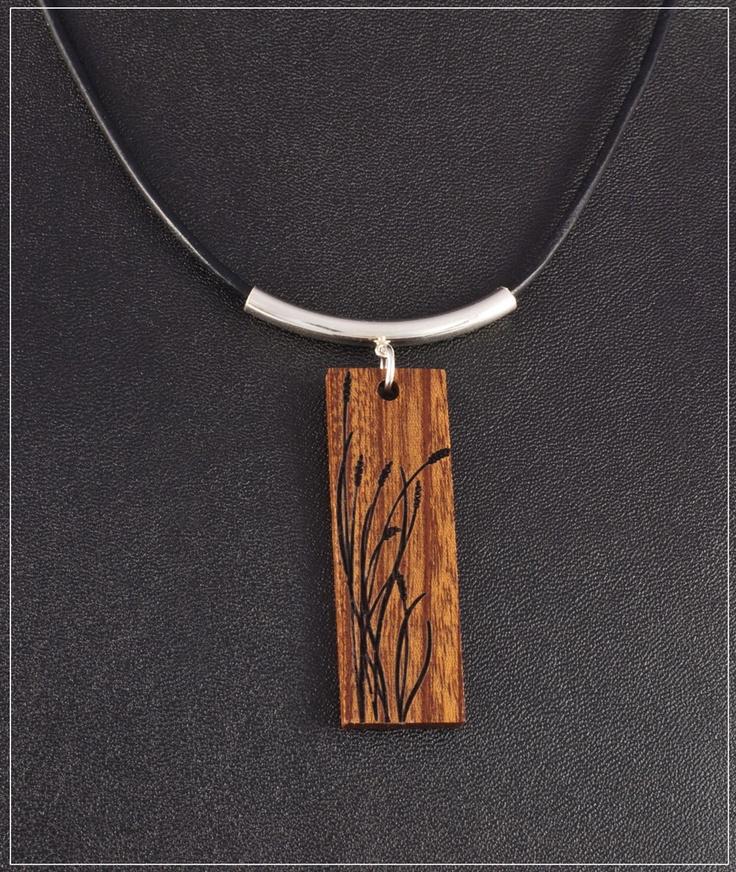 Laser Engraved Wood Pendant. $37.00, via Etsy.