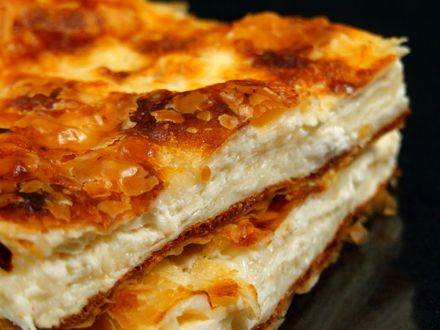 GUYS, THIS IS UNBELIEVABLE!!! Placinta (cheese and yorgurt romanian pie) Ingredients: 250 gr fresh cheese; 250g feta cheese; 3 eggs; 1 cup milk (250 ml); 1 pct fuff patry; few tablespoons of oil; 4-5 tbsp yogurt; pepper