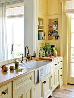 Butcher-block countertops add beach-cottage charm at a good price in this kitchen in Seaside, Florida. Buttery walls and cabinets feel warm yet open when the room is flooded with natural light. myhomeideas.com