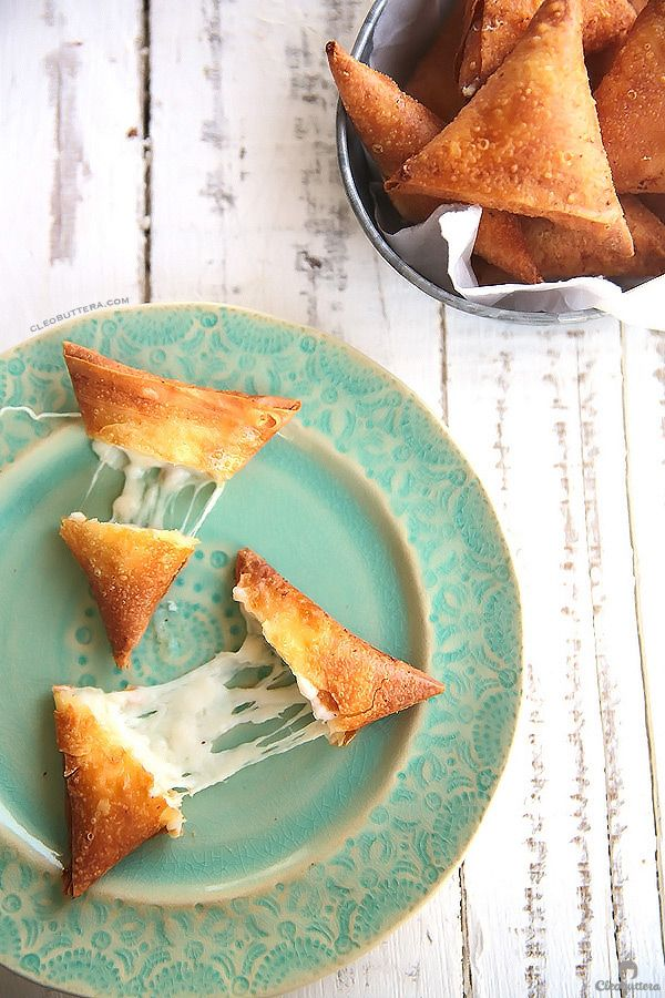 Three Cheese Samosas {A stringy, gooey mixture of mozzarella, and feta and cream cheese wrapped in a crunchy samosa dough pocket.  Could be made with phyllo!}