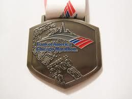 Google Image Result for http://dansmarathon.files.wordpress.com/2011/11/2009_chicago_marathon_medal.jpg