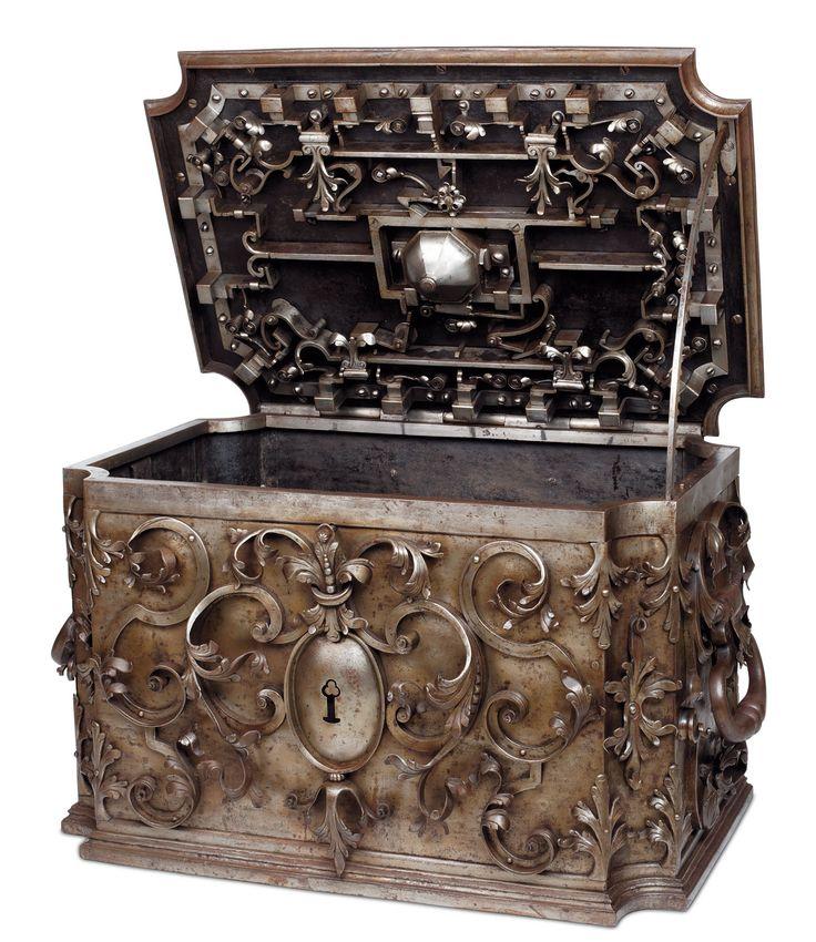 Allemagne du Sud, XVIIIesiècle. Coffre en fer forgé et sculpté, mécanisme à dix-huit pênes commandé par une serrure à dôme, 42x65x43,5cm.  Préempté par le musée LeSecq des Tournelles.  Adjugé 55 048 € frais compris