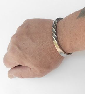 """Men's Masculine Spiral Bracelet Cuff in 1/4"""" stainless steel  I make each matt finish spiral bracelet to your wrist size.  This bold and rugged cuff has it all with it's unique look and comfortable fit. Forged from quality stainless steel with attention to detail, like how it conforms to the wrist and making sure that all the edges are smooth.  Material specifications for this cuff are, ¼"""" by ¼"""" square rod, grade 304 stainless steel."""