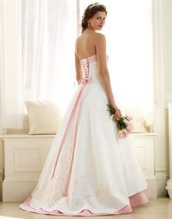 White wedding dress with color accents - a lovely rosy pink, in this case pretty. You can lace up the back and the skirt will look pretty all bunched up or not. it depends on the size of the gal.
