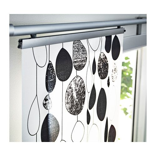 use a panel curtain ikea for covering the sliding glass kitchen door