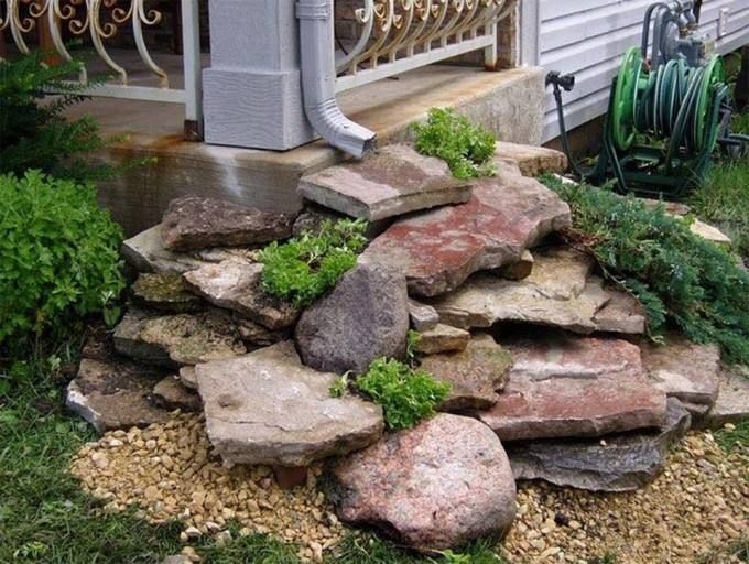 "Create your own creek starting with the downspout, then run off into a rock bottom ""ditch"" into the street."