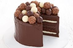 Chocolate celebration cake featuring Lindt dark chocolate balls, white chocolate balls and Ferreror Rocher chocolate balls http://www.taste.com.au/recipes/27722/chocolate+celebration+cake