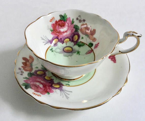 Vintage Paragon china tea cup and saucer, made in England. A beautiful duo with a white and green ground and spring flowers on both the cup and saucer. It is in good condition, no chips, cracks or crazing. Please Note: The items I sell are not new, they are vintage or antiques,