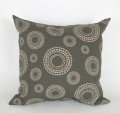 Indigi Dots cushion cover in stone on chocolate.