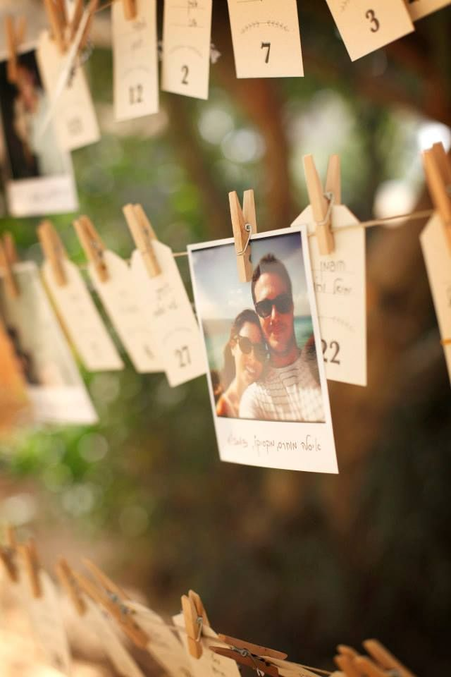 DIY wedding table number cards & Instagram photos hanging on strings