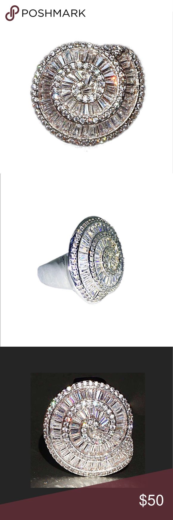 "STUNNING .925 Silver and White Sapphire Ring NWT STUNNING .925 Silver and White Sapphire Ring NWT:  this ring is GORGEOUS.  White sapphires laid side-by-side in a conch-shell pattern for maximum shine.  Most definitely a ""statement"" ring!  Tends to run about 1/2 size large. Jewelry Rings"