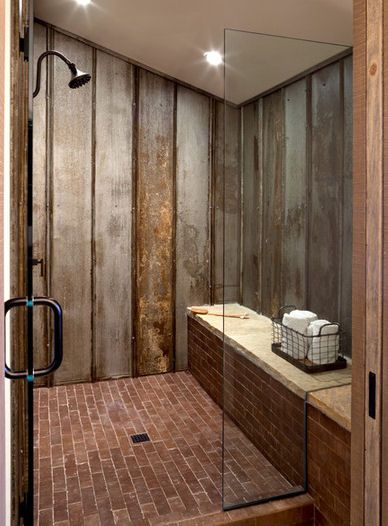 salvaged galvanized steel siding used on shower walls with brick floors
