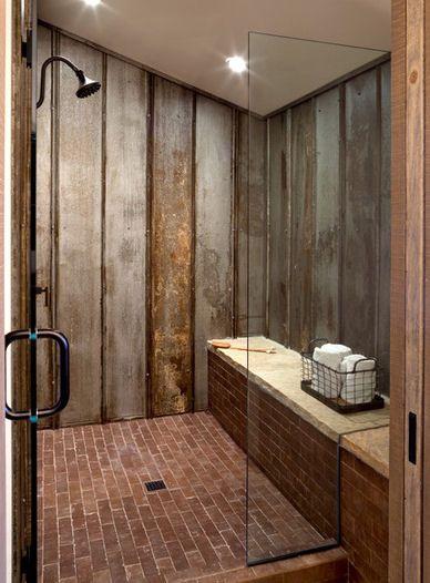 salvaged galvanized steel siding used on shower walls with brick floors