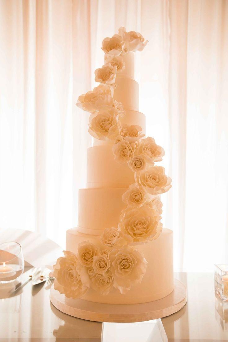 Tall, Elegant Wedding Cake with Flowers | Photo: Duke Photography. View More: https://www.insideweddings.com/weddings/persian-american-wedding-with-mirror-detailing-in-newport-beach-ca/862/
