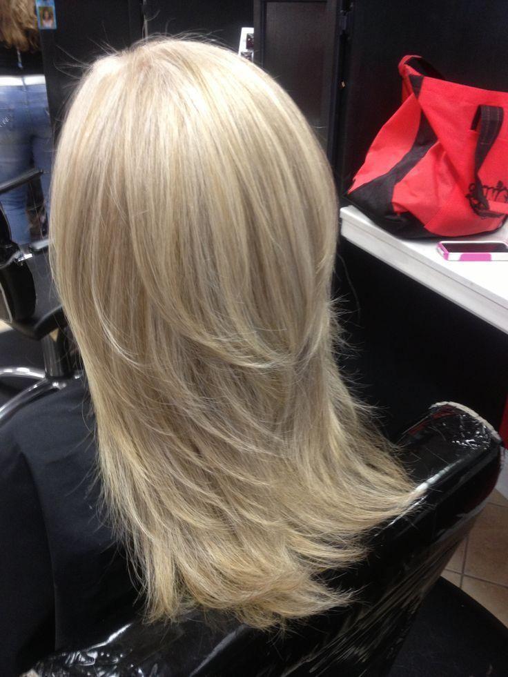 Blonde layered hair by Kalee