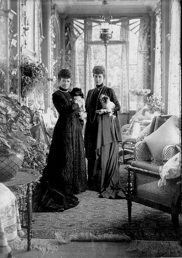 The sisters with their companion animals at their villa, Hvidøre, in Denmark.
