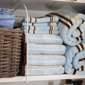 8 Ideas for Organizing Your Linen Closet - Essentials | Wayfair