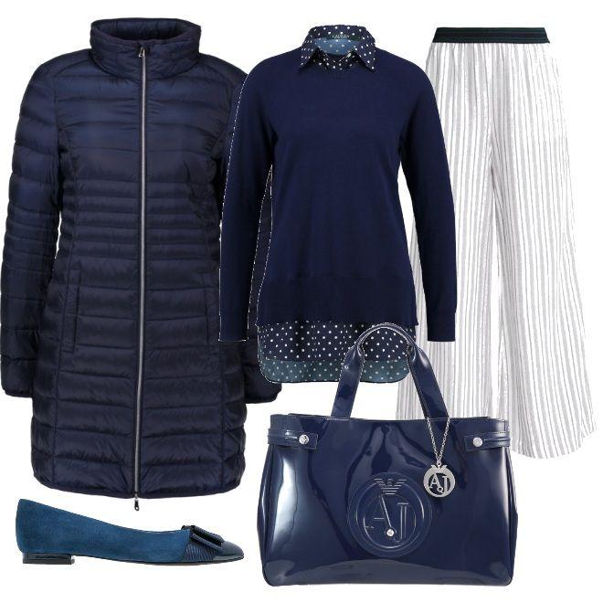Le righe dei pantaloni si abbinano ai pois della maglia blu , da indossare sotto un piumino blu e con delle ballerine con fiocco e una borsa a mano in vernice: proposta semplice e comoda .