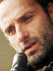 SEASON 3 - RICK, THINKING HE SAW SOMETHING OUTSIDE THE PRISON GATES.  IT WAS ANDREA - WHO HAD JUST BEEN PINNED DOWN TO THE GROUND BY THE GOVERNOR.
