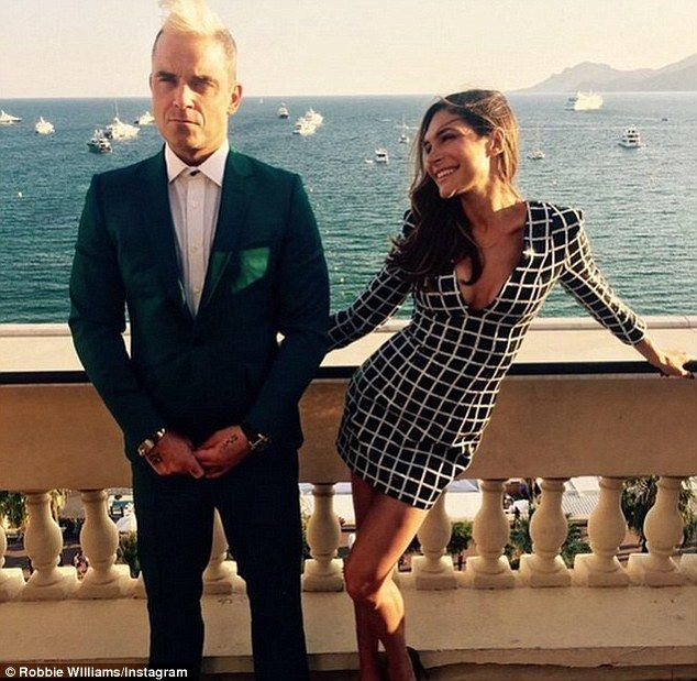 United front: Robbie Williams and his wife Ayda Field have posed for a fun snap, posted on...