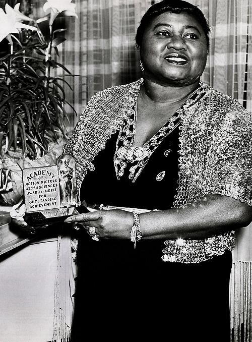 Hattie McDaniel with her Academy Award for Best Supporting Actress in Gone With The Wind, 1940.