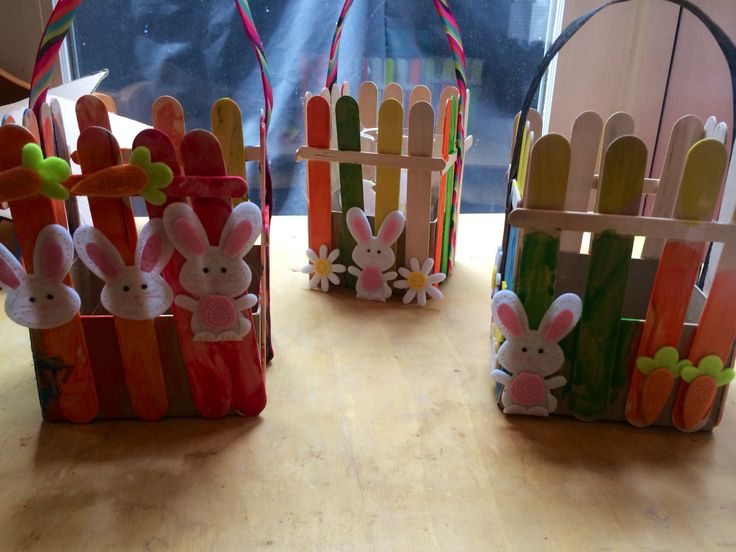 Here is how our baskets turned out.  We used tacky glue to attach the Popsicle sticks.  We used ribbon for the Handle.   Folded the ribbon over glued together with tacky glue to make it stiff.  So the handle will stay standing.  Then attached it with hot glue. The bunnies are just felt stickers.  I did attach them w/ hot glue so they didn't just pop off.