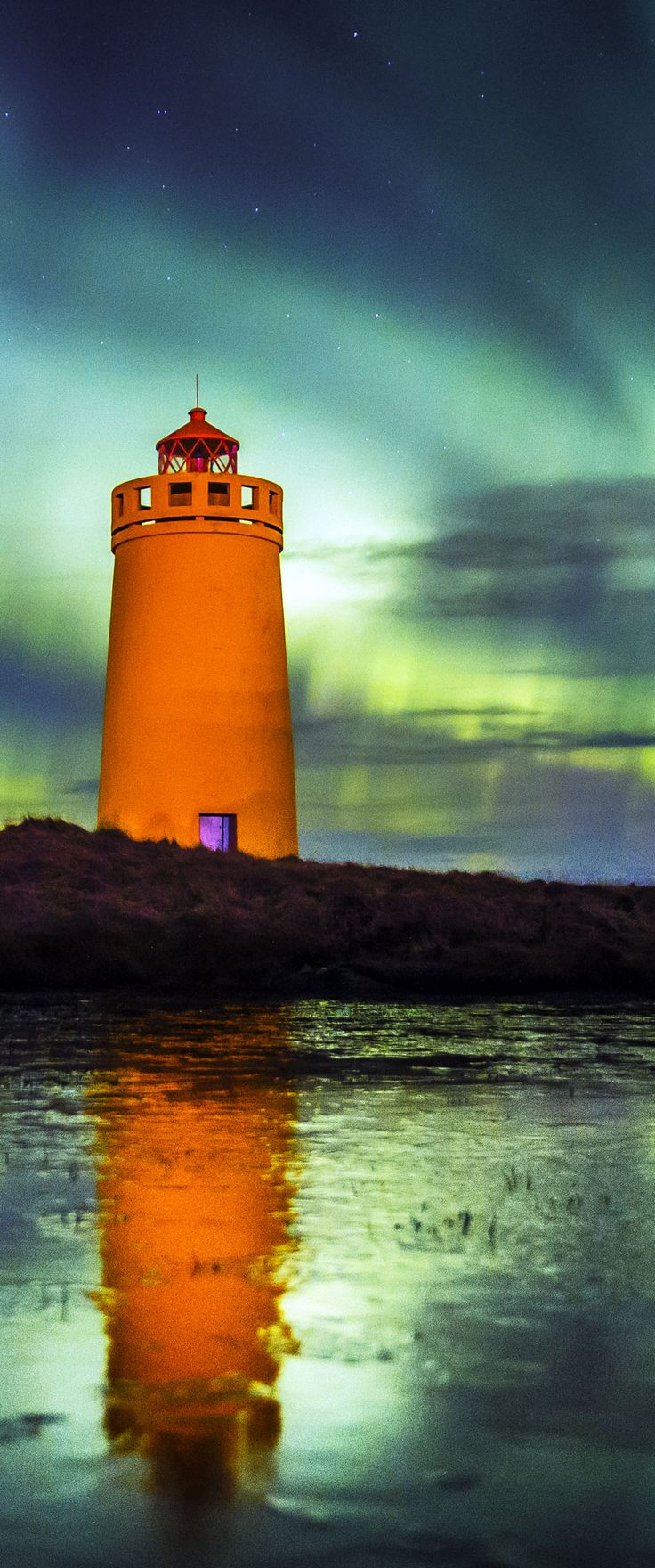 Northern Lights by the Lighthouse, shot in Iceland.    |    16 Reasons Why You Must Visit Iceland Right Now. Amazing no. #12