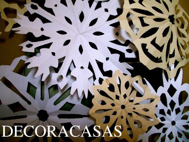 E imaginar que tudo isto iria para o lixo... Flocos de neve de papel  www.decoracasas.com.br