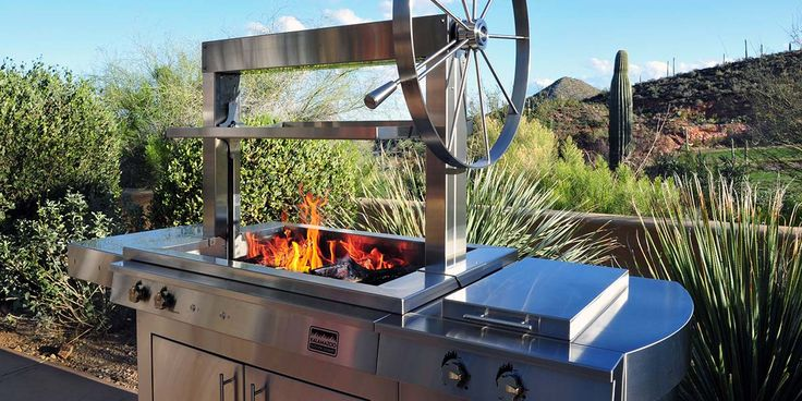 Argentinian-style wood-fired grill and rotisserie K750GS Gaucho Wood-fired Freestanding Grill with Side Burner