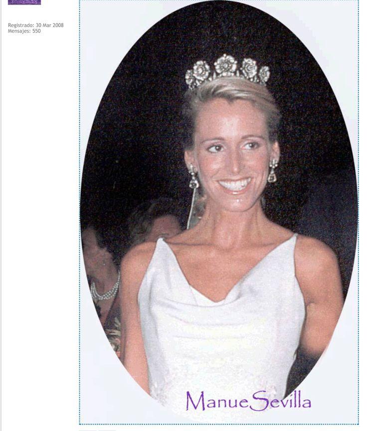 Princess Tessa of Bavaria wearing a floral tiara featuring five flower heads.